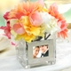 Our Square Glass Vase with Photo Frame is a unique way to display your most prized picture. Because of its unique versatility, this dual frame and vase works great as a decorative centerpiece at wedding receptions, bridal showers, or even as a gift for a bridal party attendants. Bring them home and embellish everything from fireplace mantles to end tables with all your most cherished memories and decorations. Each table vase adds an exquisite decorative element to any special event and when the party is over it easily becomes a showpiece in your home for many years to come.