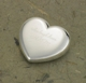 "Your true love won't have a heavy heart when you give him/her this symbol of your affection. Ideal for home or office, our personalized silver-plated heart-shaped paper weight, fashioned from durable brass, is a constant reminder of your love as well as a useful desk accessory for that busy man or woman in your life. Makes a great wedding favor, too! Measures 2"" x 3/4"". Personalized with two lines of up to 20 characters per line."