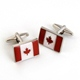 Oh Canada! Pay homage to this great nation with our Dashing Canadian Flag Cufflinks. Proudly display the cherished maple leaf whether youre donning a formal tuxedo or just your daily dress shirt. The pair comes packaged in an attractive personalized silver-tone case featuring the name of the recipient. Yes, we do ship to Canada. Please allow extra time and there is an additional $12.00 for shipping. Either place your order online or call us at 800-683-0027.