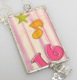 "Our celebrate 16th birthday necklace is a fun and trendy gift idea to give to a special girl turning sweet 16. The framed dog tag style necklace is on an 18"" ball chain sterling silver necklace with sweet 16 and drivers license sterling silver charms."