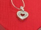 "Send a romantic and meaningful gift idea to someone special. Packaged in a heart shaped gift box. Sterling Silver 18"" Chain with Lobster Clasp Heart pendant with Swarovski Crystals"